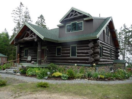 East Lodge - a unique custom built log home in the heart of the Maine woods facing the ocean.