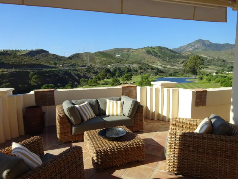 Main terrace. Outstanding views over the golf course and down the valley.
