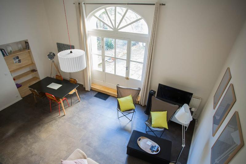 Cosy loft with garden in central location, holiday rental in Albaron