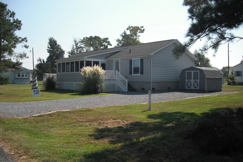 Open deck and enclosed screen porch - house located on a quiet lane.