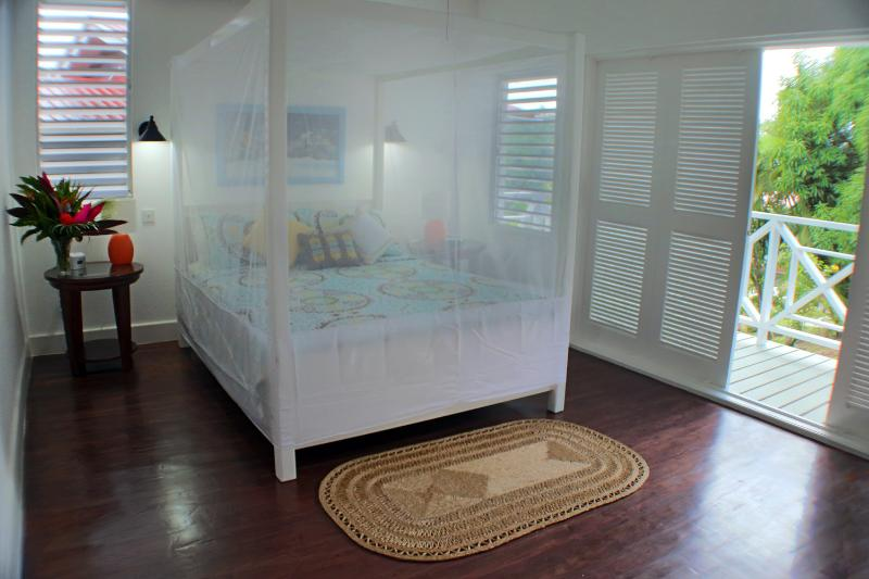 Cozy Bedrooms With French Shutter Doors, Bed Nets, and A/C...