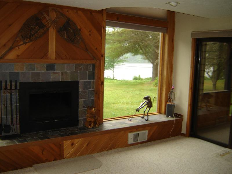 Livingroom fireplace, slate hearth, picture windows with lake view