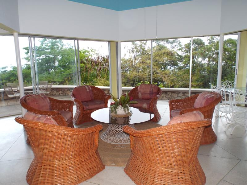 The Sun Room has a great view of the Caribbean and seating for 11!