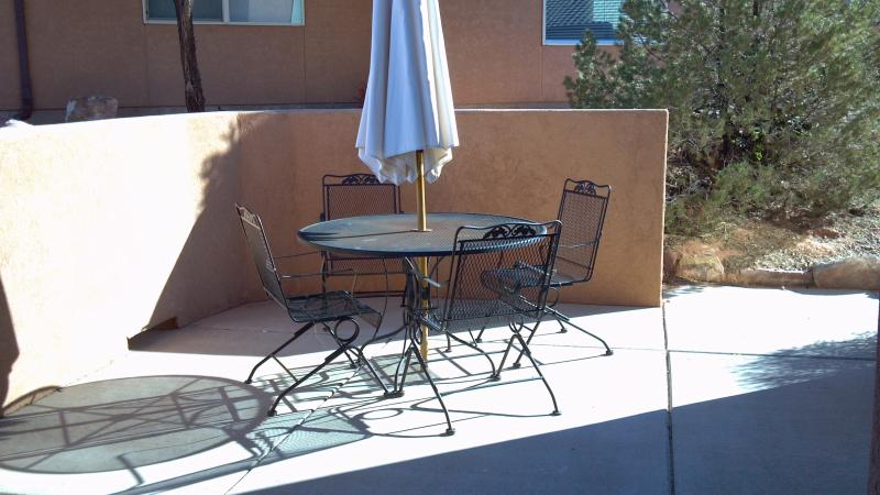 Outdoor furniture on the patio provides more room to enjoy the outdoors and the grill.