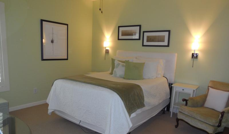 Master suite enjoys sunrises.  Closets have plenty of room for all your golf and party clothes.