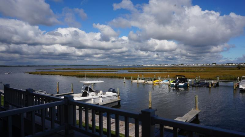 Look at this view!  Unobstructed bay and wetlands views.