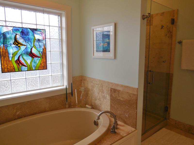 Beautiful glass shower has great water pressure to ease those tired muscles after any event.