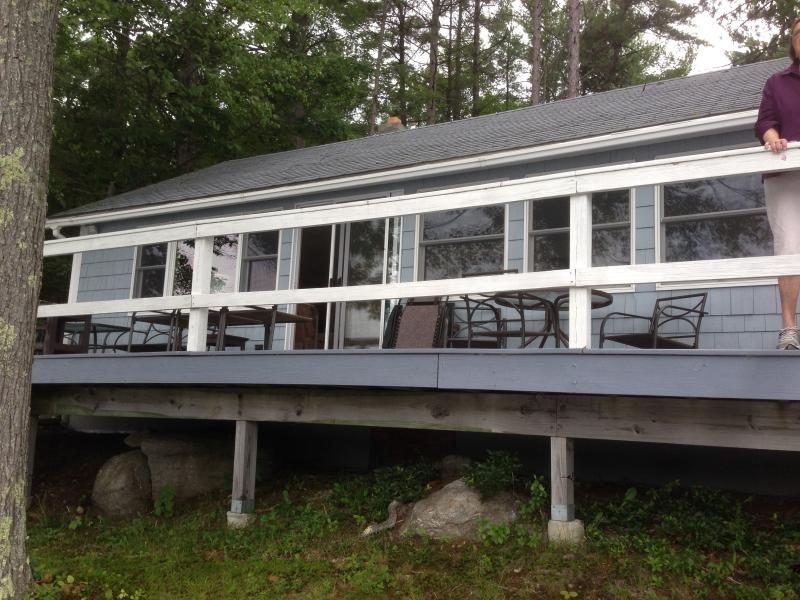 Cottage is perched on water's edge