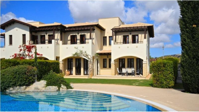 Rear of villa with patio areas,private garden just steps from the pool