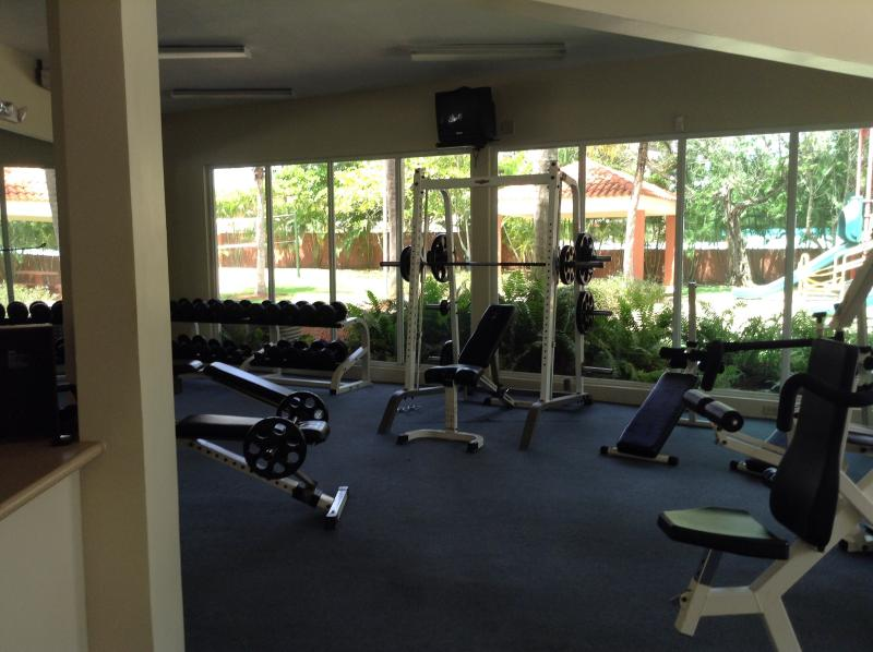 Fitness room overlooking one of the pools.