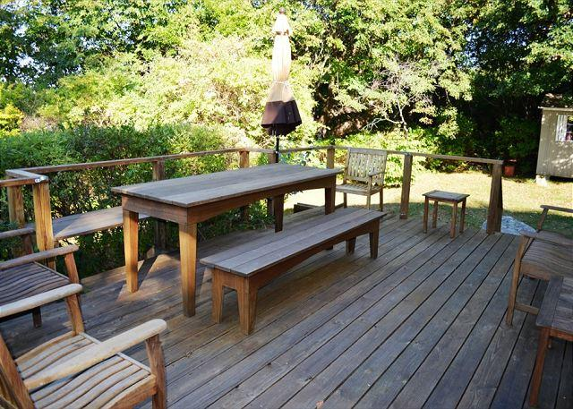Main Floor deck with table and benches.