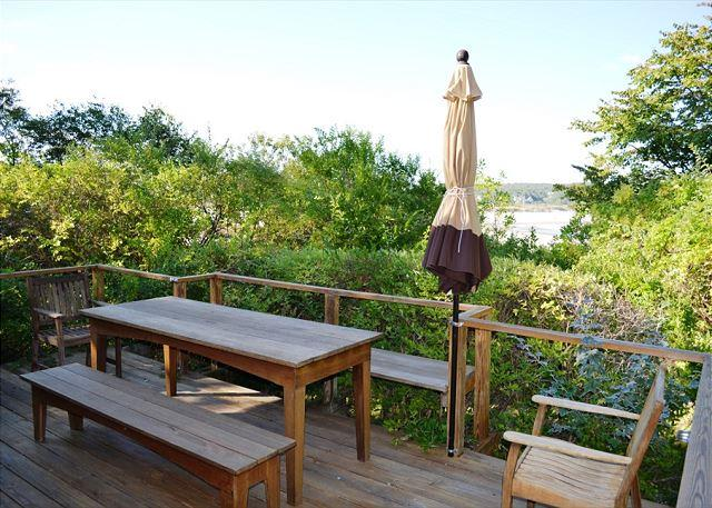 Main Floor deck with table and benches. Good Harbor Beach can be