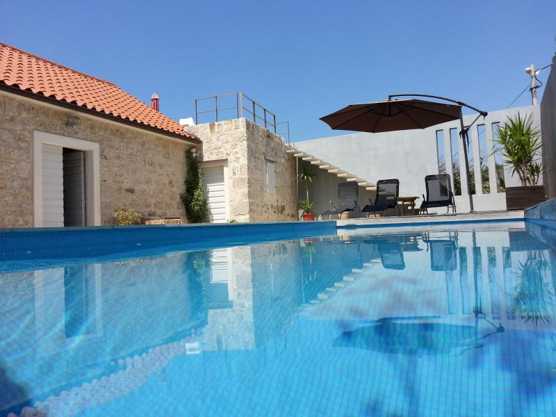 100 year old villa with pool, stunning views, holiday rental in Podgora