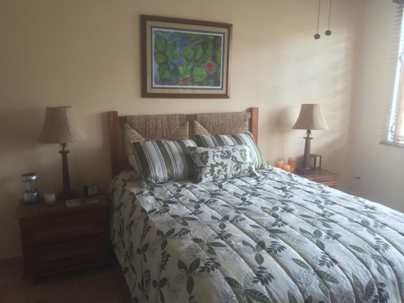 Master bedroom with queen bed,balcony,and full bath