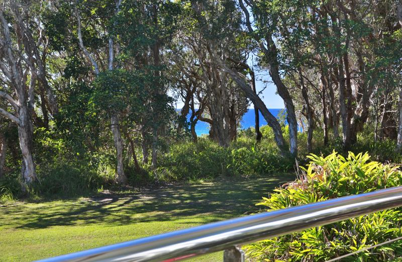 View from your private deck, through the forest to ocean.