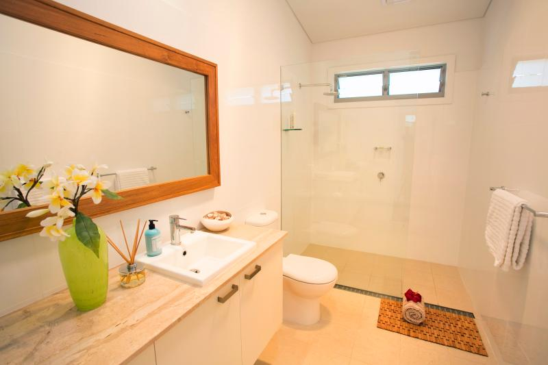 Spacious holiday bathroom, organic amenities.