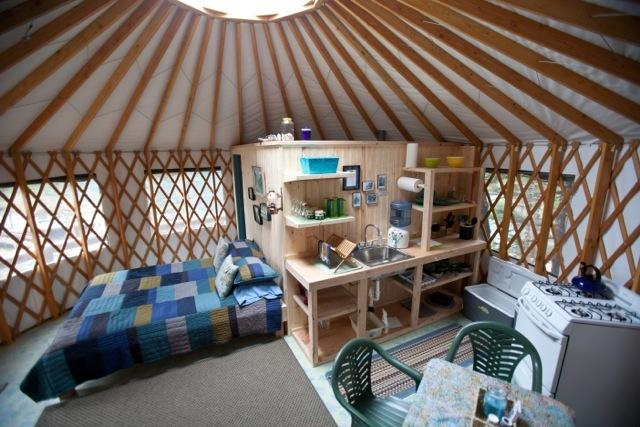 each yurt cabin, has a kitchenette and private bathroom