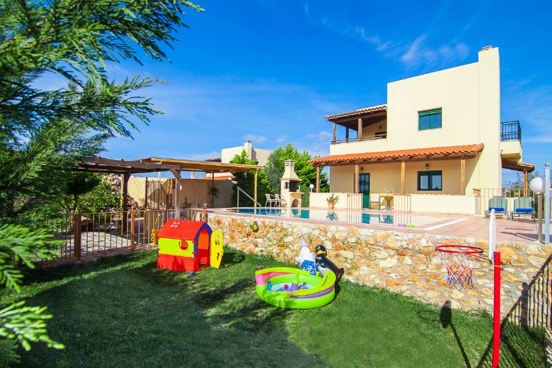 Outdoor area  - swimming pool and fenced playground for children