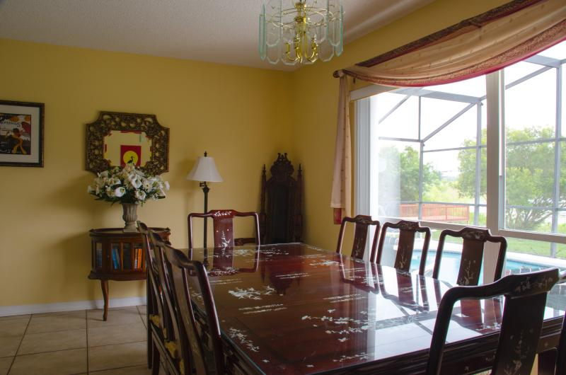 Dining room with beautiful ornate table with seating for up to 8 guests