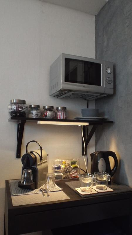 nespresso, watercooker, microwave, totally silence fridge ! plates ect.