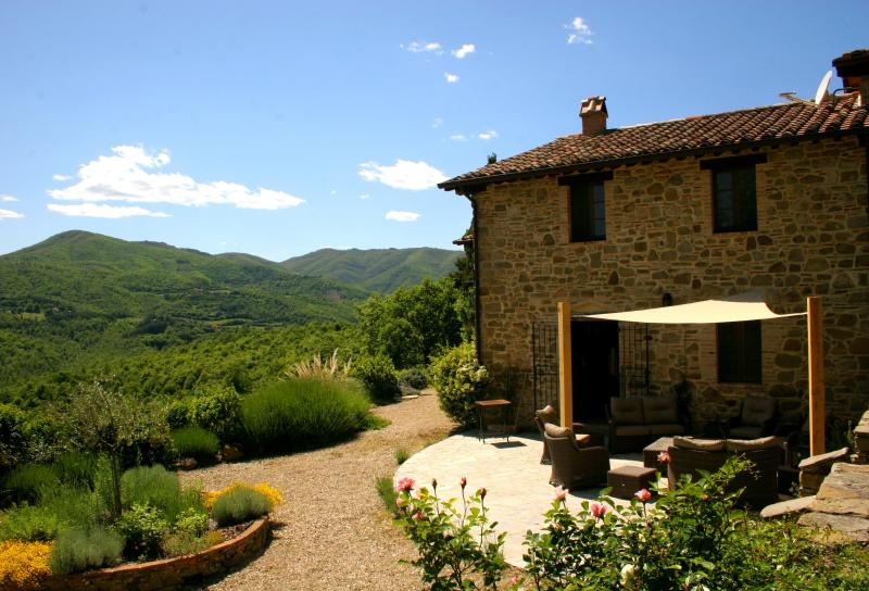 The east side of the farmhouse villa Casa Colcello. Sunshine all day long