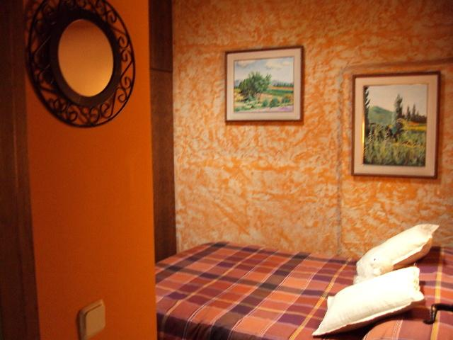 Room with window on the roof from where contemplate the stars. Double bed with co