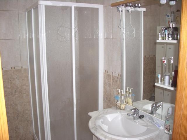 There is a large shower room with a shower, sink, toilet and bidet