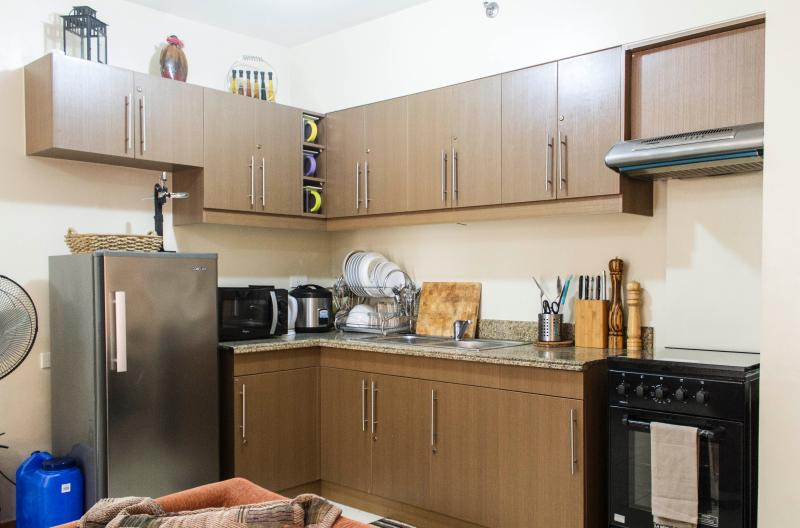 Kitchen Area with Fridge, Microwave, Electric Kettle, Cookwares and Utensils