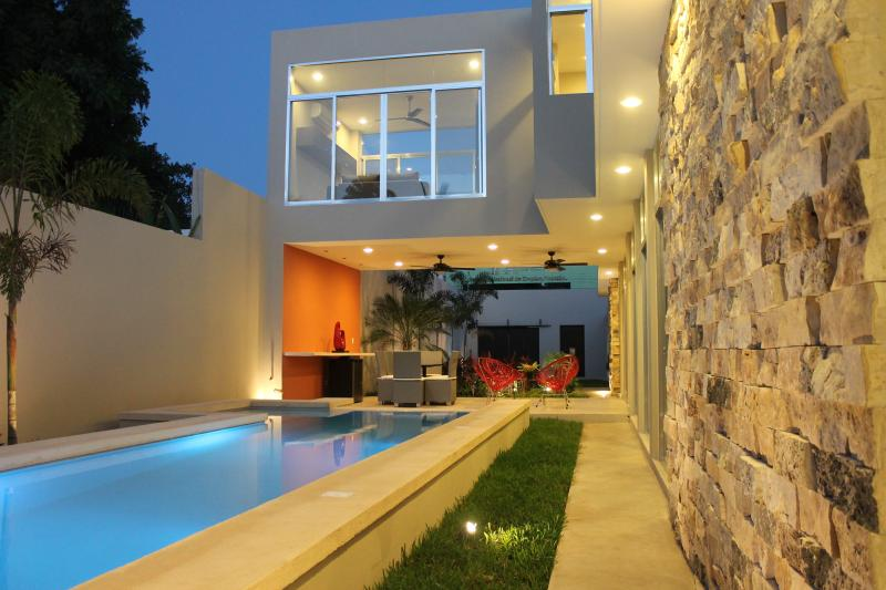 View of pool, terraza and upstairs entertainment room