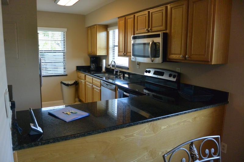 Kitchen with granet counter tops and stainless steel appliances