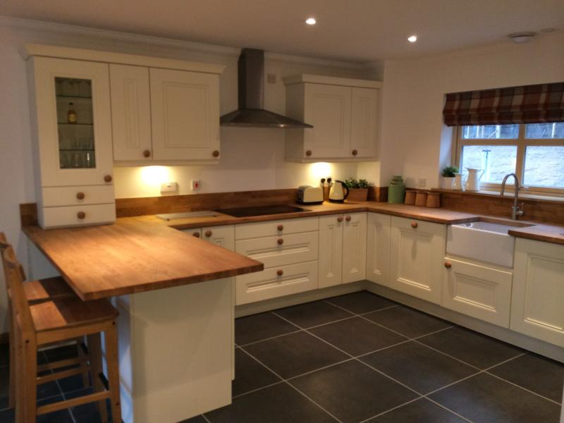 country style kitchen equipped with modern appliances