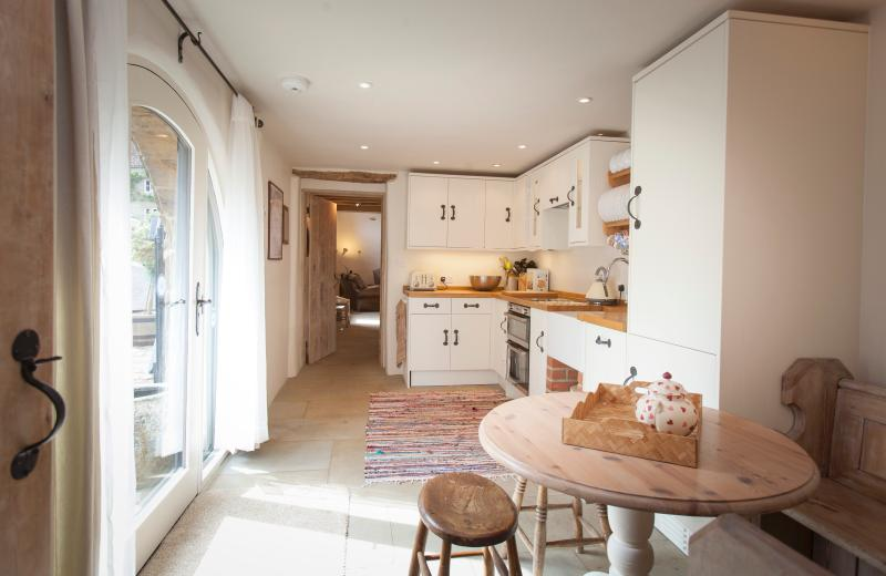 Enjoy the sunny kitchen with views onto the green and dovecot