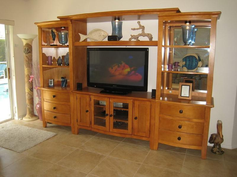 Our entertainment unit houses a large HD TV & Home Theatre System