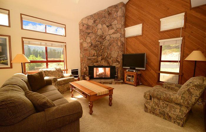 Aspen Creek #4 Living Area With A Wood Burning Fireplace And A Queen Sofa Bed