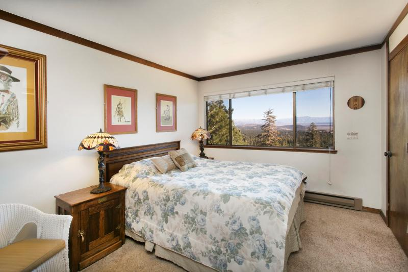 Master Bedroom With A Queen Bed and A Fantastic View