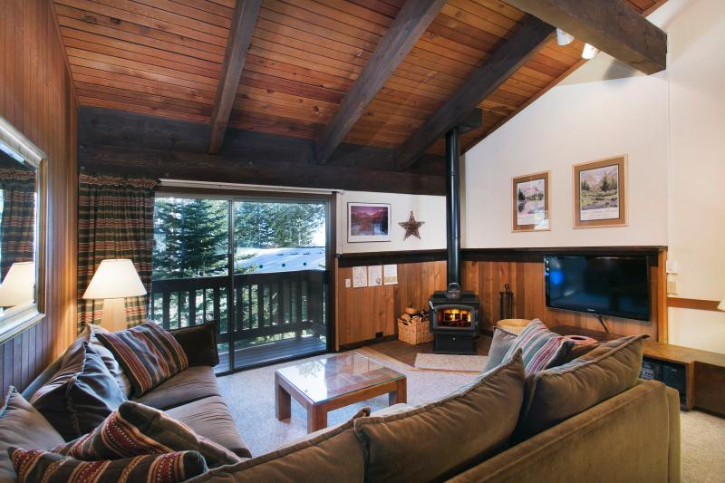 Mammoth Point #131 Living Area With A Double Sofa Bed and A Wood Burning Fireplace