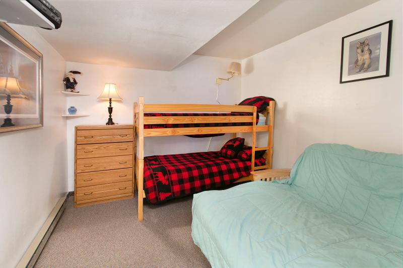 Fourth Bedroom With A Twin Bunk Bed And A Double Futon