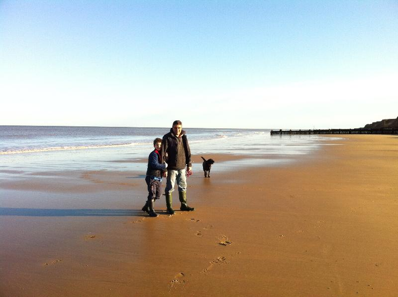 Guests enjoying a December walk on the beach, it's great all year at Sheringham