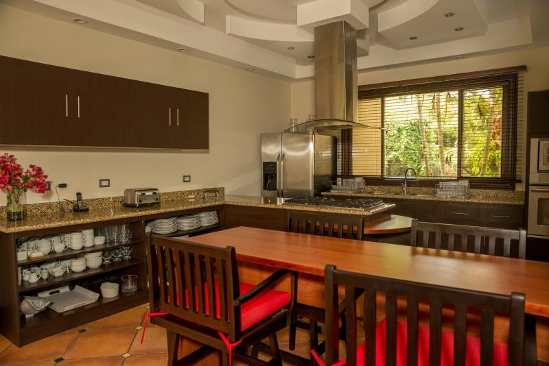 The residence's kitchen is fully equipped, including a grill