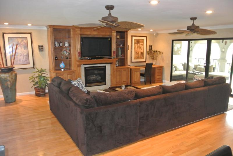 Large relaxing family room with Tommy Bahama fan, 55 inch tv and access to back porch
