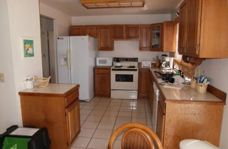 Kitchen has refrigerator w/ ice maker, stove, dish washer, garbage disposal