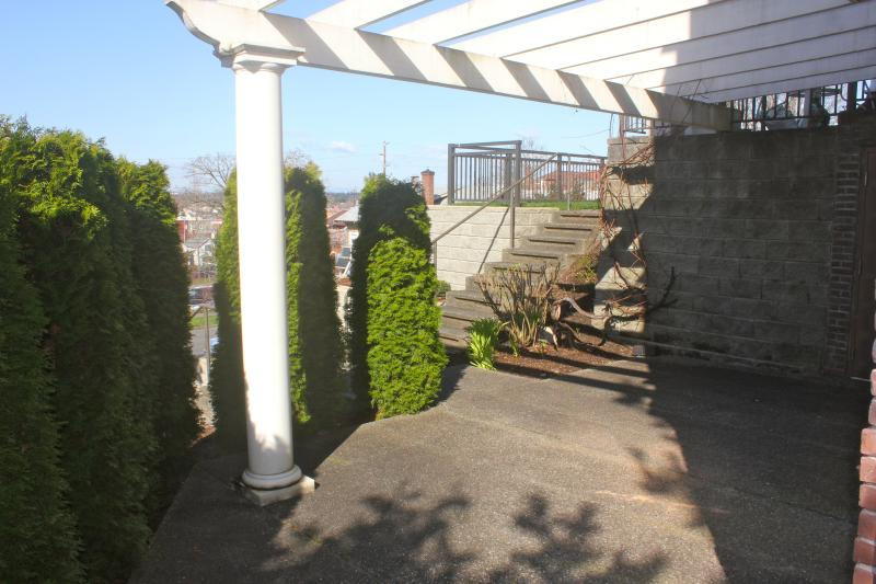 Front patio, with bay view beyond. Patio furniture comes out for relaxation and outdoor sitting in t