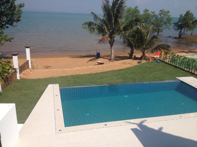 View for master bedroom & bedroom 2 over pool, garden, beach & sea.