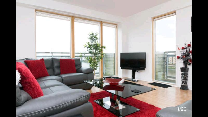 Front room with floor to ceiling windows overlooking the Clyde - with two 16ft balconies