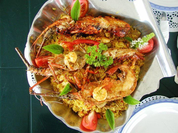 Paella, prepared by our chef, with home caught products, Lobster, Shrimp and fish