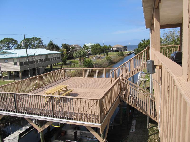 Large over the canal deck, with 2 boat lifts and fish cleaning station below.