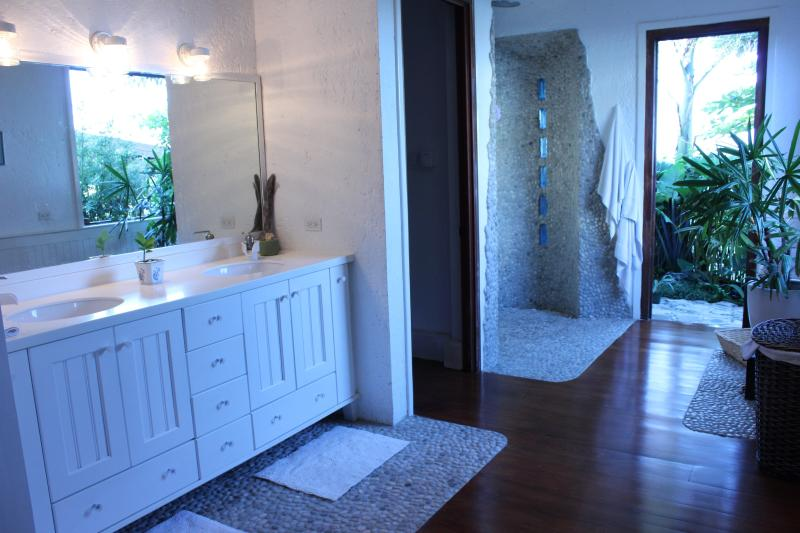 Master bathroom  double sink, double shower,  enclosed toilet and bidet and outdoor garden shower.