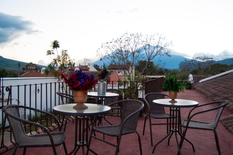 Villas de la Ermita 06 / Roof Top Terrace - Sunset view of Fuego & Acatenango Volcanoes