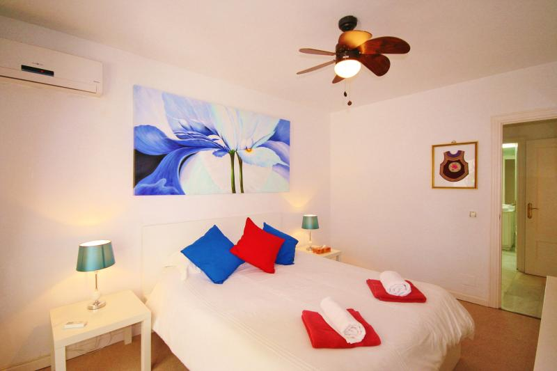 Master bedroom, Terrace with doors to lush communal gardens and pool, Walking to beach and town.