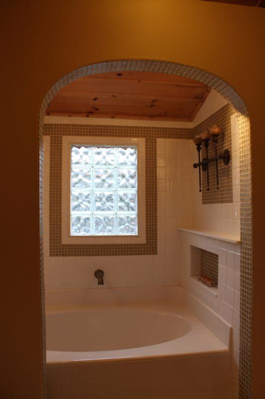 DEEP SOAKING GARDEN TUB in ENSUITE MASTER BATH alcove with Candle Sconces